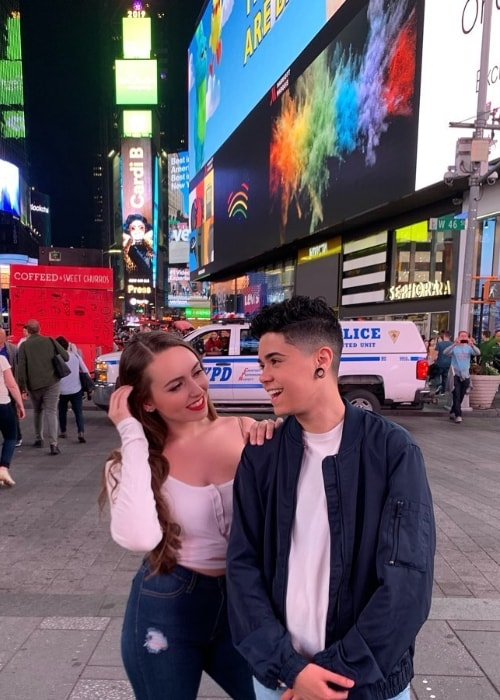 A1Saud as seen while posing for an adorable picture along with Julia Raleigh at Times Square located in Manhattan, New York City, New York, United States in June 2019