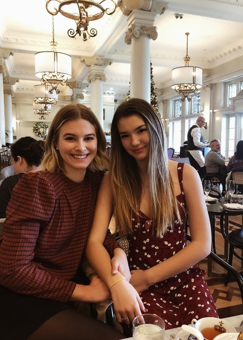 Ali Skovbye (Right) as seen while posing for a picture along with her older sister, Tiera Skovbye, at Hotel Fairmont Empress in Victoria, British Columbia, Canada in December 2018