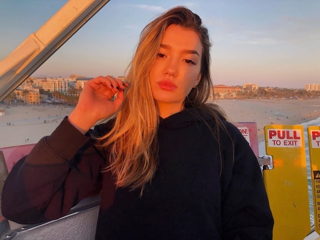 Ali Skovbye as seen while posing for a picture during the golden hour at Santa Monica Pier in Santa Monica, Los Angeles County, California, United States in May 2019