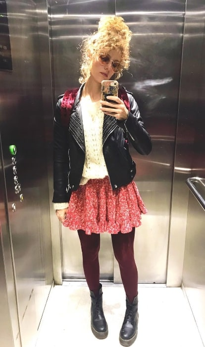 Esther Acebo as seen while taking a mirror selfie in an elevator in February 2019