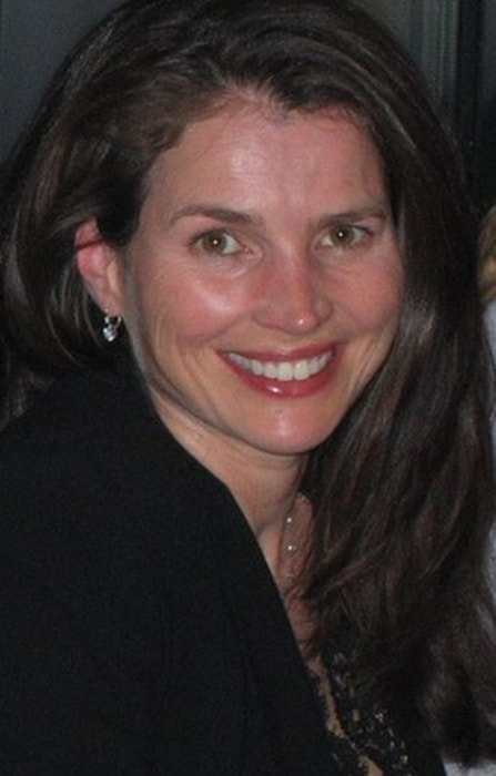 Julia Ormond as seen while smiling for the camera in September 2005
