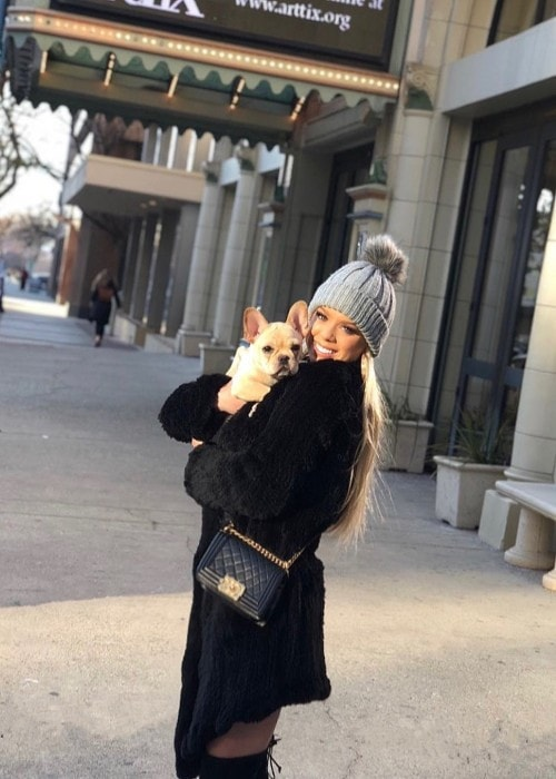 Kaylyn Slevin with her dog as seen in December 2018