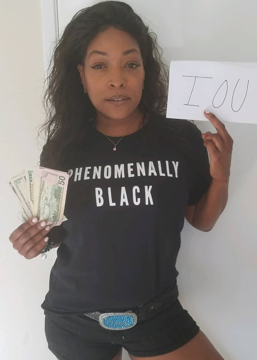 Kellita Smith as sen in a picture taken while supporting Black Women's Equal Pay Day in August 2019