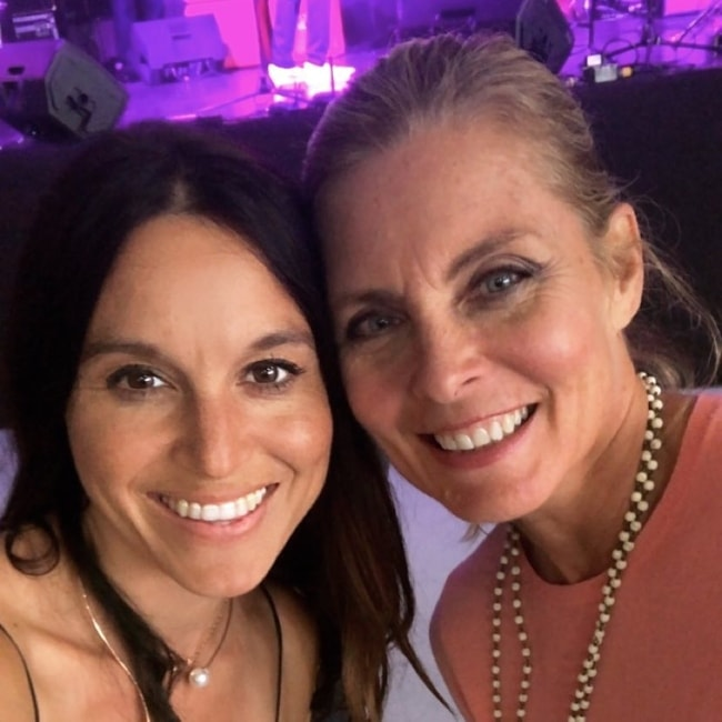 Kim Alexis (Right) as seen while posing alongside Liliana Burgi at the CASA Kane Country event in May 2018