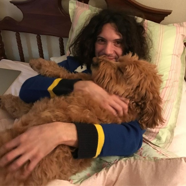 Dan Avidan with his dog as seen in December 2018