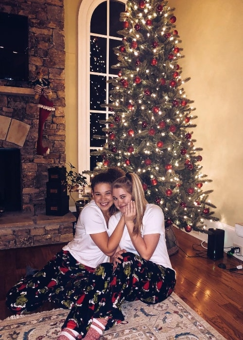 Madison Haschak (Left) as seen while posing for a Christmas picture along with Julia Reilly in December 2018