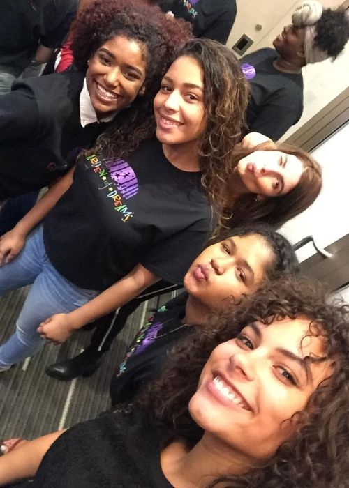 Marquita posing with girls from the Garden of Dreams foundation in 2017