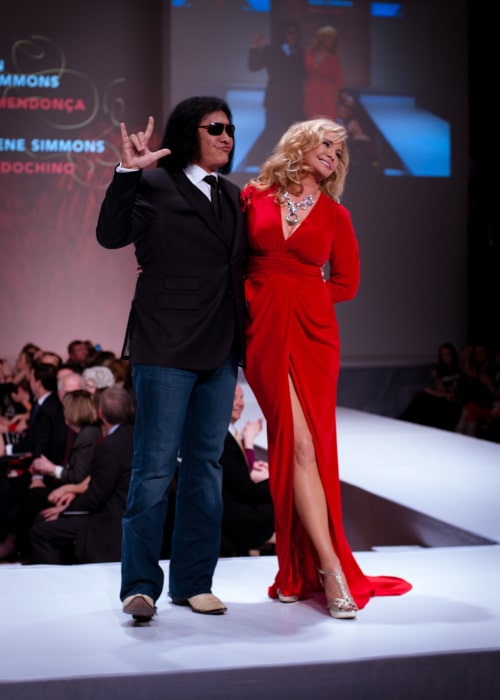 Shannon Tweed as seen in a picture with her husband Gene Simmons while walking the ramp at the Heart and Stroke Foundation's The Heart Truth celebrity fashion show in March 2012
