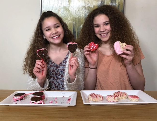 Sierra Haschak (Left) as seen while posing for a picture along with her older sister, Madison Haschak, showing their DIY Valentine's Day Heart Treats in February 2018