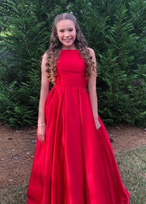 Sierra Haschak as seen while posing for a picture wearing a beautiful red dress for her prom in April 2019