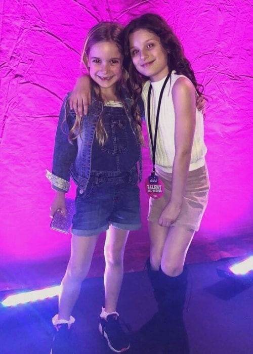 Tilly Mills (Left) as seen while posing for the camera alongside social media star Hayley LeBlanc in April 2018