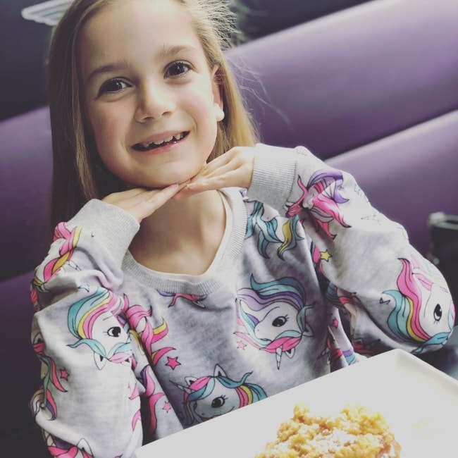 Tilly Mills as seen while smiling for a picture while enjoying her apple crumble at Creams Cafe Windsor in Berkshire, England, United Kingdom in May 2019