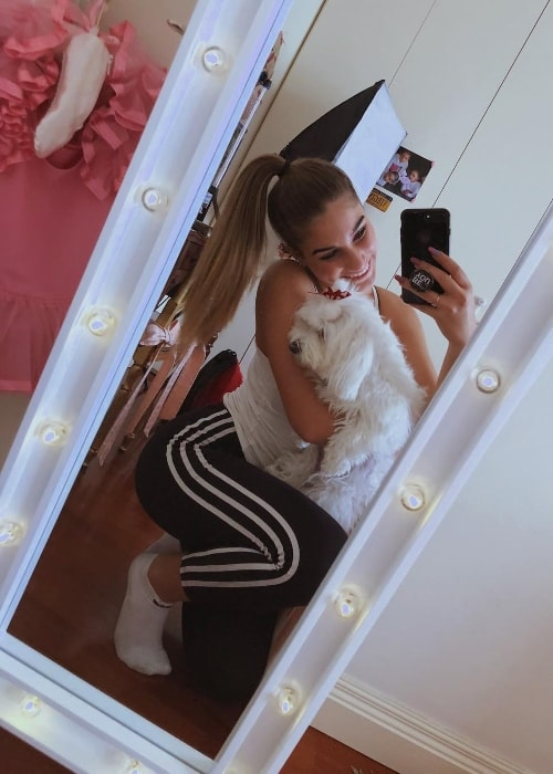 Virginia Montemaggi as seen while taking a mirror selfie with a dog in December 2018