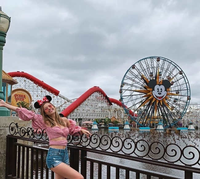 Afra Saraçoğlu as seen while posing for a picture at Disney California Adventure Park in Anaheim, California, United States in July 2019