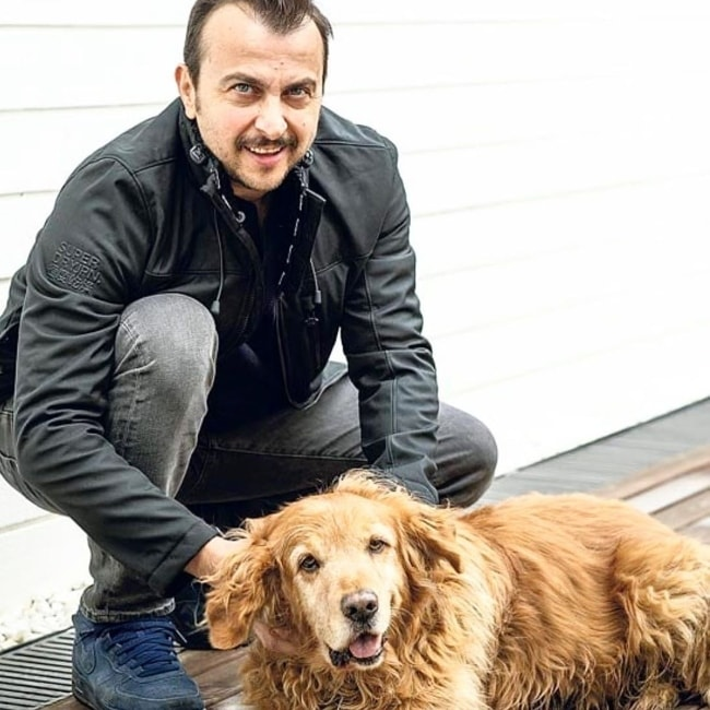 Ali Atay as seen while posing alongside an adorable dog in July 2019