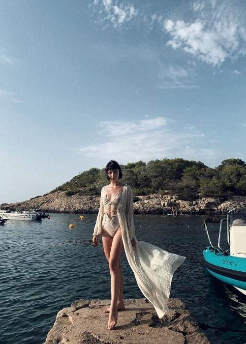 Alice Pagani as seen while posing for a picture with a stunning setting in Ibiza, Spain in August 2019