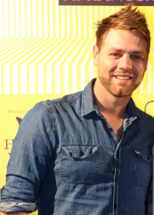 Brian McFadden posing on the red carpet of the APRA Music Awards in 2012