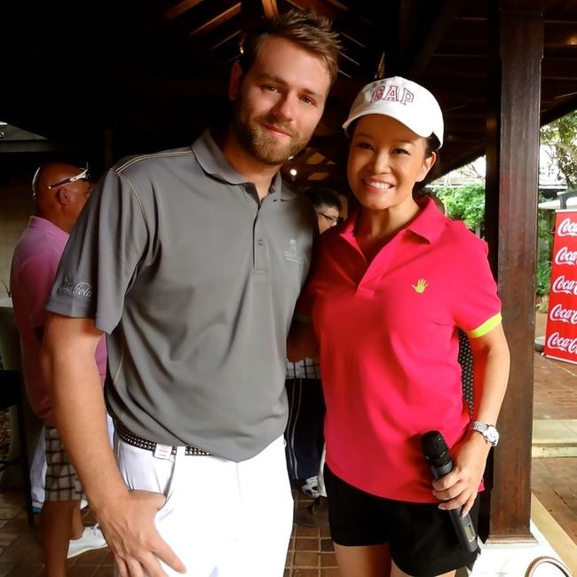 Brian McFadden with TV presenter Jennifer Su at the Gary Player Invitational in 2012