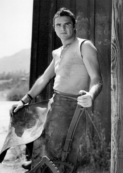 Burt Reynolds as seen while posing for the camera as blacksmith Quint Asper from the television program 'Gunsmoke'