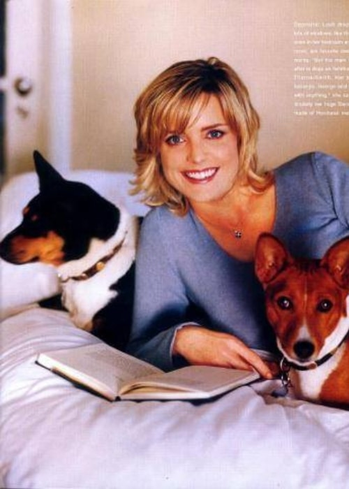 Courtney Thorne-Smith as seen while posing for a picture alongside two adorable dogs