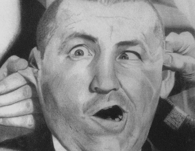 Curly Howard as seen in a black-and-white picture