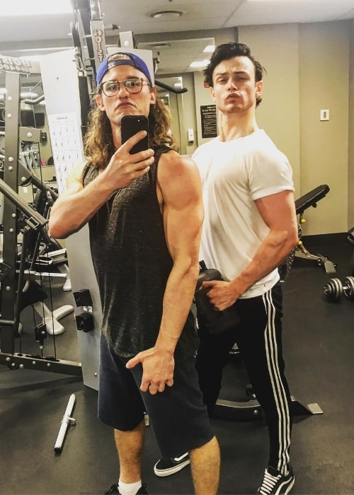 Dylan Playfair as seen while clicking a goofy gym mirror selfie alongside Thomas Doherty in June 2018