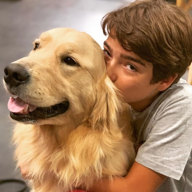 Elias Harger as seen while kissing Cosmo, the family dog on 'Fuller House', at the Warner Brothers Studios in Burbank, Los Angeles County, California, United States in July 2019