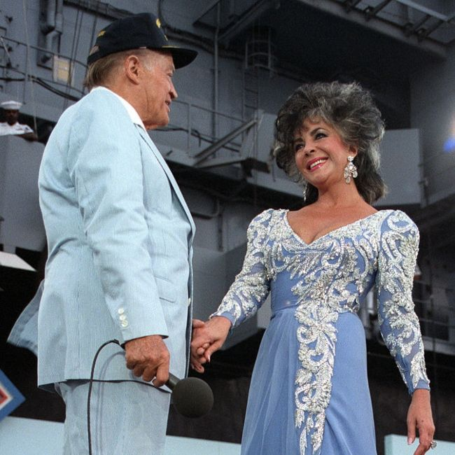 Elizabeth Taylor performing with Bob Hope during a show to mark the 75th anniversary of Naval Aviation in 1986