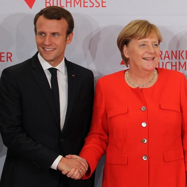 Emmanuel Macron shaking hands with German Chancellor Angela Merkel in October 2017