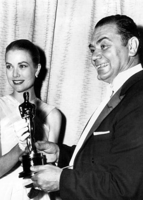 Ernest Borgnine as seen in a black-and-white picture while receiving academy award for 'Marty' from Grace Kelly in March 1956