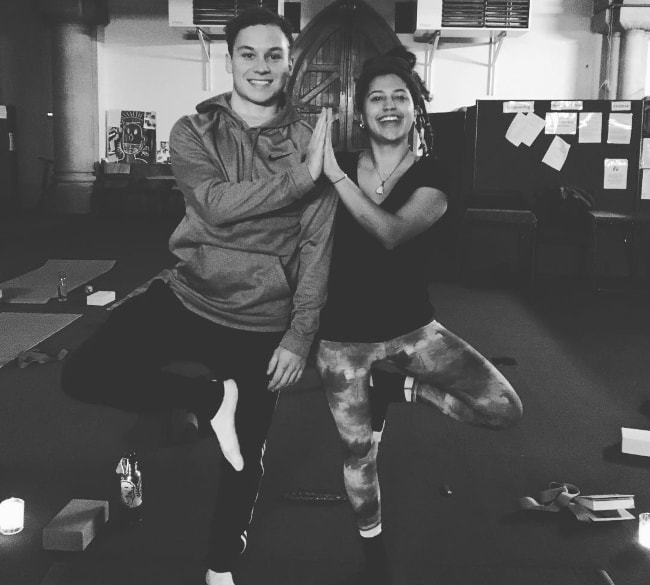 Finn Cole as seen while posing in a black-and-white picture along with his friend and yoga teacher, Georgie Edwards, in January 2018