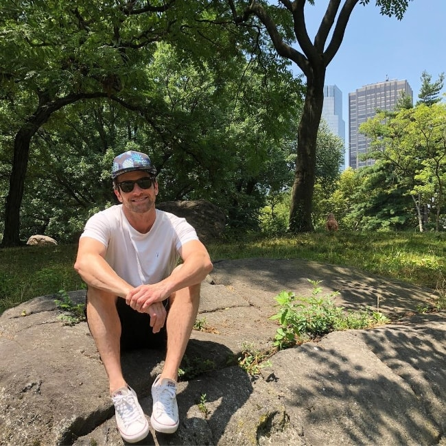 Ian Bohen as seen while sitting and posing for a picture in Central Park in Manhattan, New York City, New York, United States in July 2018