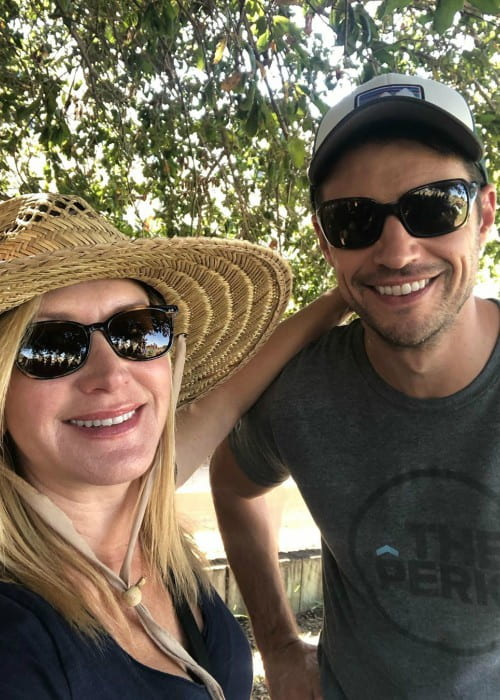 Joshua Snyder and Angela Kinsey in a selfie as seen in October 2019