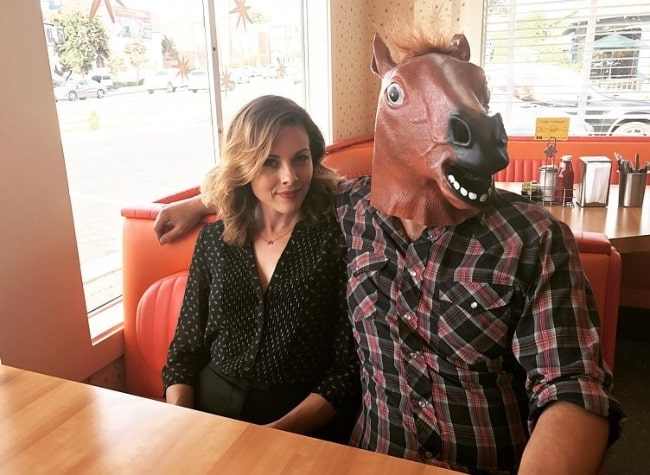 Julie Mond as seen in a picture alongside Mike Postalakis, wearing a fake horse head, in Cindy's Eagle Rock Restaurant in July 2017