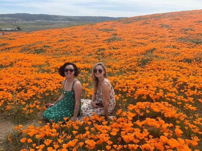 Keisha Castle-Hughes (Left) posing for a picture along with Christina Collard in Antelope Valley California Poppy Reserve located in Los Angeles County, California‎, United States in April 2019