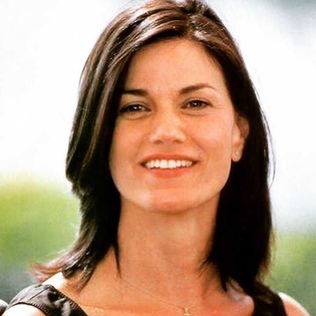 Linda Fiorentino as seen while smiling in a picture