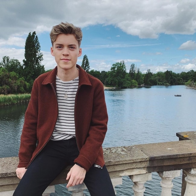 Reece Bibby as seen while posing for a picture with a magnificent backdrop at Hyde Park located in Central London, London, England, United Kingdom in May 2019