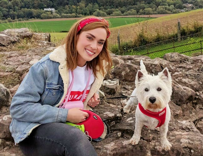 Rose Ellen Dix with her dog as seen in October 2018