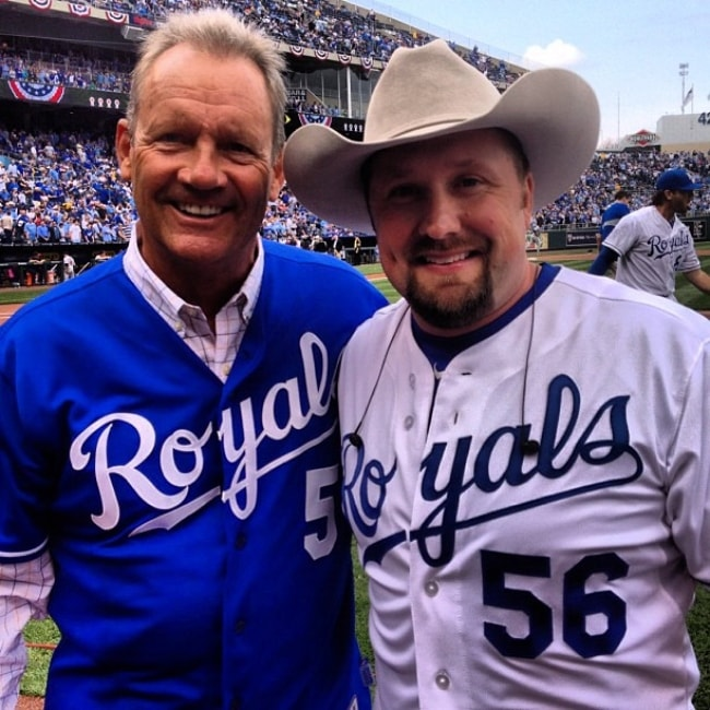 Tate Stevens (Right) as seen while posing for a picture along with baseball legend George Brett in April 2013