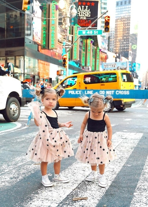 Taytum Fisher and Oakley Fisher as seen in a picture at Times Square in Manhattan, New York City, New York, United States in July 2019