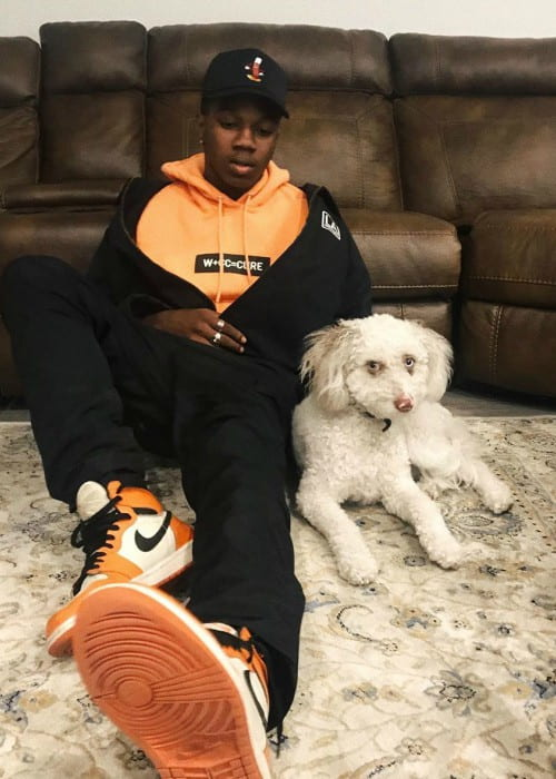 Tayvion Power with his dog as seen in July 2019