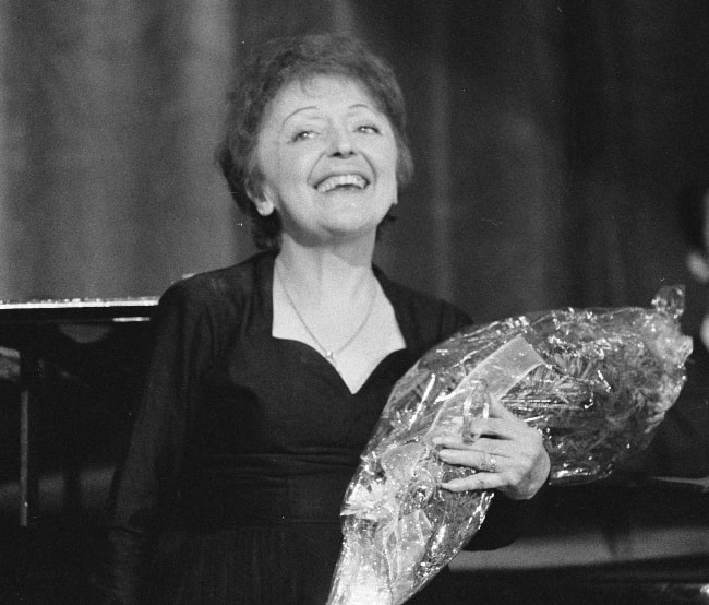 Édith Piaf as seen while smiling in a picture in December 1962
