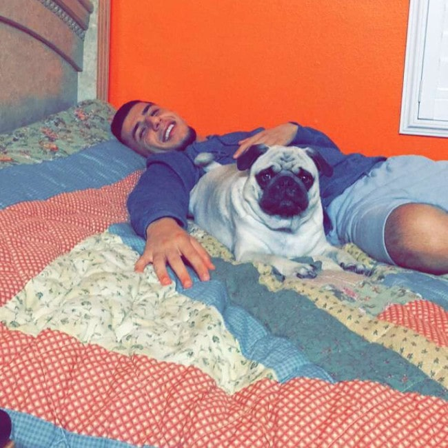 Brandon Awadis with his dog as seen in March 2018