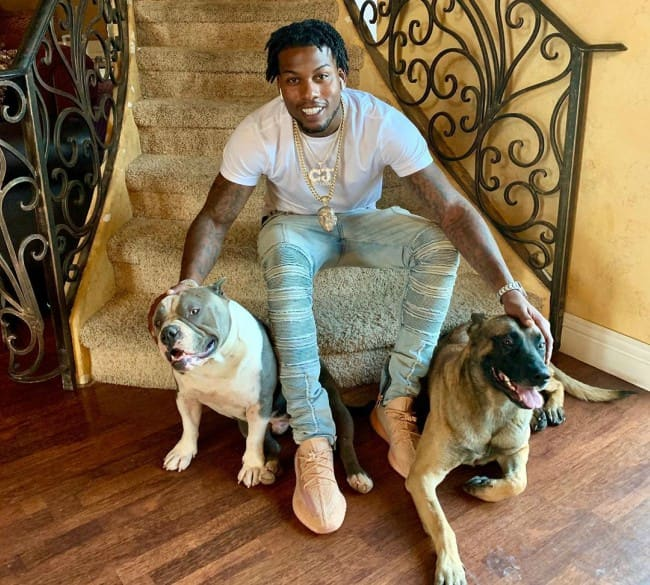 CJ So Cool with his dogs as seen in May 2019