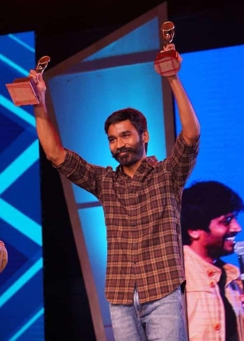 Dhanush as seen in a picture taken after being given the best actor award from Anna university Techofes awards in March 2019