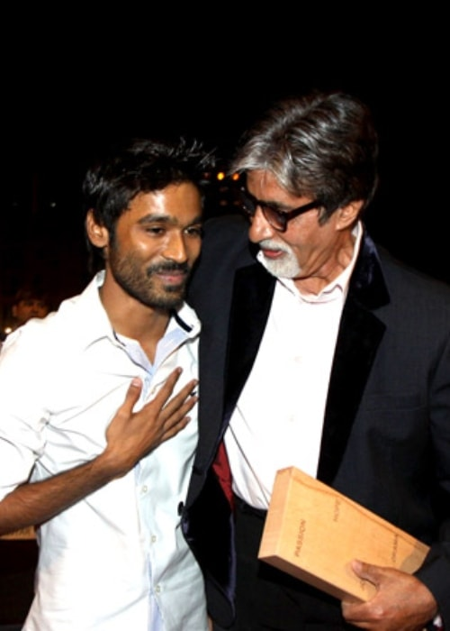 Dhanush as seen in a picture with Bollywood sensation Amitabh Bachchan taken in July 2012 at the at the BIG Star Entertainment Awards