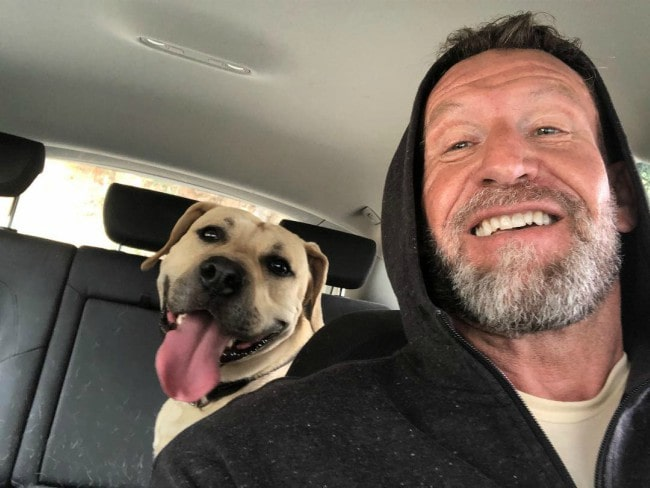 Dorian Yates in a selfie with his dog as seen in March 2019