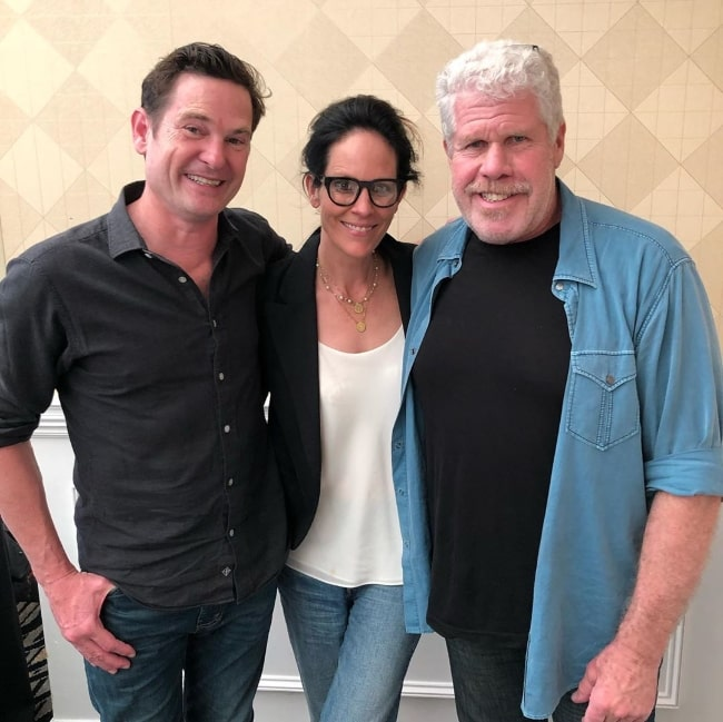 Henry Thomas (Left) as seen while posing for a picture along with Annabeth Gish and Ron Perlman