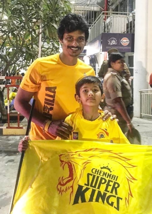 Jiiva as seen in a picture with his son Sparsh Choudary holding the banner of their home team Chennai Super Kings in May 2019