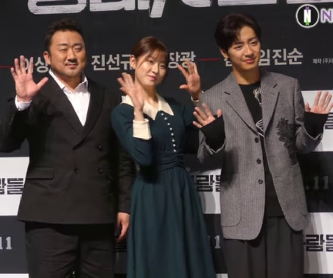 Ma Dong-seok (Left) as seen while posing for a picture along with Kim Sae-ron and Lee Sang-yeob (Right) in October 2018